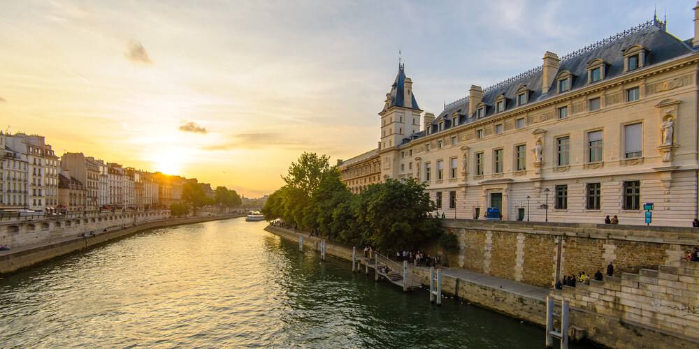 Riverside Of Seine River In Paris France By The Sunset